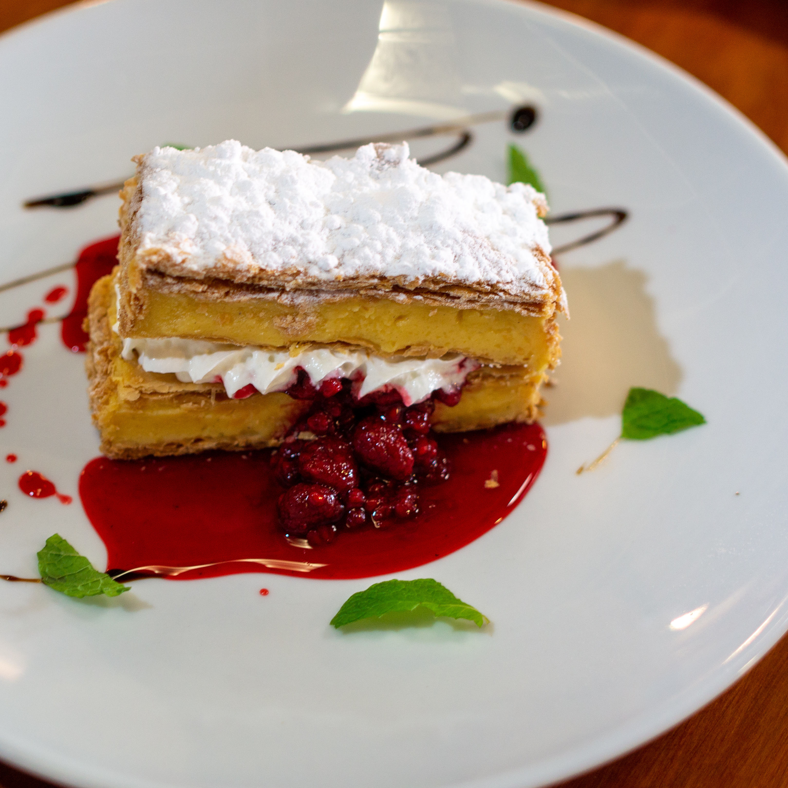 Layer cake with berry sauce