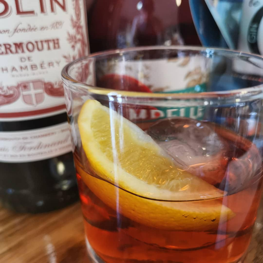 Vermouth cocktail with lemon wedge